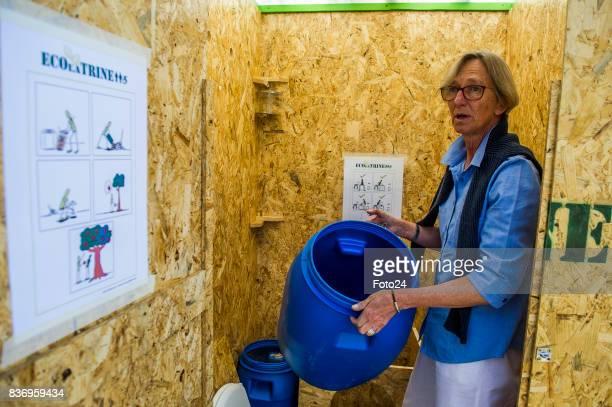 Henriëtte Vermaak demonstrates how the ecofriendly mobile toilet oppertates on August 15 2017 in Johannesburg South Africa Henriëtte Vermaak along...