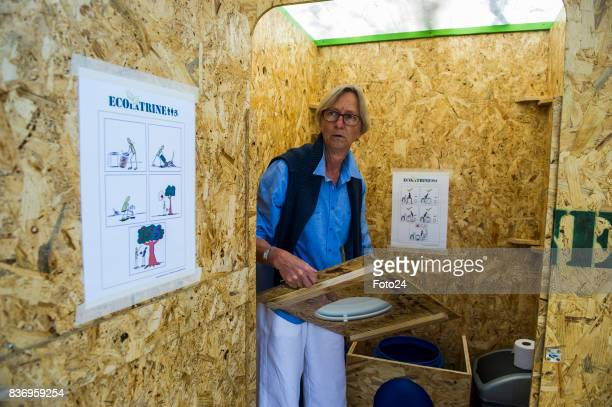 Henriëtte Vermaak demonstrating how the ecofriendly mobile toilet opperates on August 15 2017 in Johannesburg South Africa Henriëtte along with...