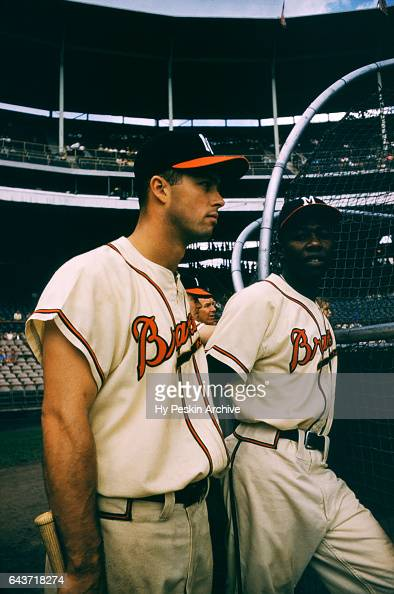 Henry Aaron and Eddie Mathews of the Milwaukee Braves wait their turn to hit in the cage during batting practice before an MLB game against the St...