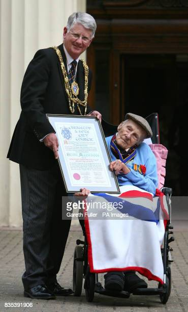 Henry Allingham receives a scroll at Brighton Town Hall in Brighton East Sussex from Mayor of Brighton and Hove Cllr Gary Peltzer Dunn as he is made...