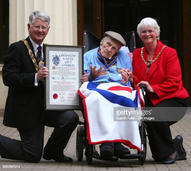 Henry Allingham recieves a scroll at Brighton Town Hall in Brighton East Sussex from Mayor of Brighton and Hove Cllr Gary Peltzer Dunn accompanied by...