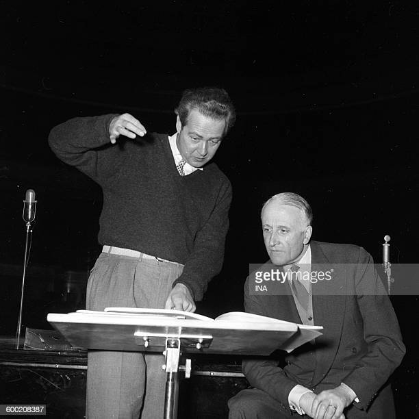 Henry Barraud and an orchestra conductor study together a score before a concert which will be given to the Théâtre des Champs Elysées and broadcast...