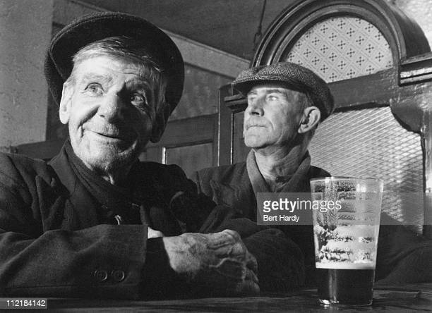 Henry Barter with a pint of Guinness at John Mullet's bar in Amiens Street Dublin 22nd August 1953 Original Publication Picture Post 6666 Ireland's...