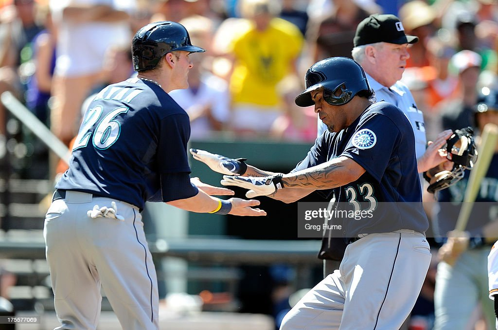 <a gi-track='captionPersonalityLinkClicked' href=/galleries/search?phrase=Henry+Blanco&family=editorial&specificpeople=211366 ng-click='$event.stopPropagation()'>Henry Blanco</a> #33 of the Seattle Mariners celebrates with <a gi-track='captionPersonalityLinkClicked' href=/galleries/search?phrase=Brendan+Ryan&family=editorial&specificpeople=835643 ng-click='$event.stopPropagation()'>Brendan Ryan</a> #26 after hitting a home run in the seventh inning against the Baltimore Orioles at Oriole Park at Camden Yards on August 4, 2013 in Baltimore, Maryland.