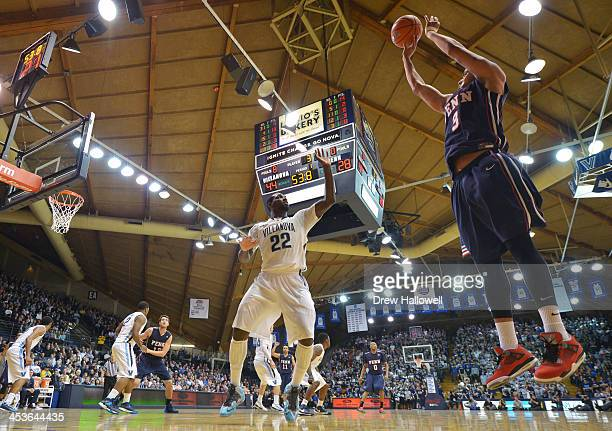 Henry Brooks of the Pennsylvania Quakers gets off a shot over JayVaughn Pinkston of the Villanova Wildcats at the Pavilion on December 4 2013 in...