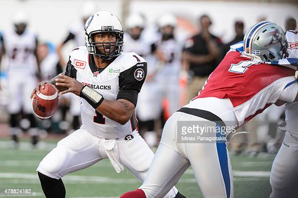 Henry Burris of the Ottawa Redblacks looks to pass the ball during the CFL game against the Montreal Alouettes at Percival Molson Stadium on June 25...
