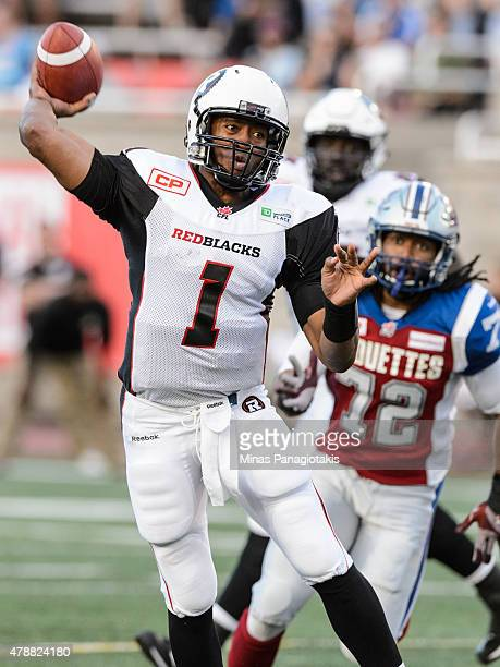 Henry Burris of the Ottawa Redblacks prepares to throw the ball during the CFL game against the Montreal Alouettes at Percival Molson Stadium on June...