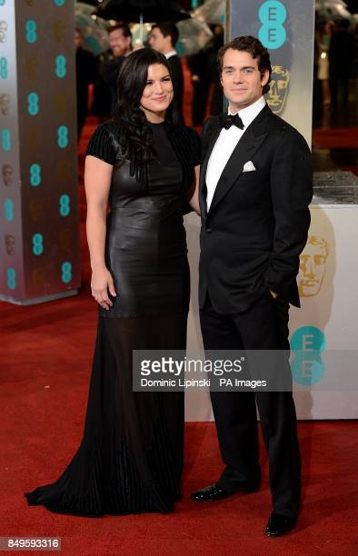 Henry Cavill and Gina Carano arriving for the 2013 British Academy Film Awards at the Royal Opera House Bow Street London
