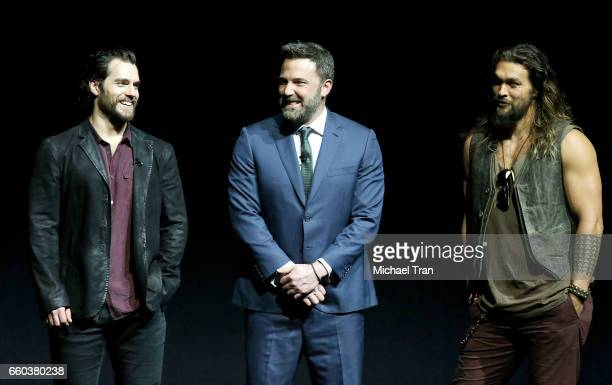 Henry Cavill Ben Affleck and Jason Momoa speak onstage at the CinemaCon 2017 Warner Bros Pictures presentation held at The Colosseum at Caesars...