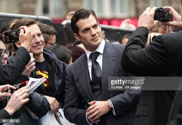 Henry Cavill poses for a photo as he arrives for the European premiere of Man of Steel at the Odeon Leicester Square London