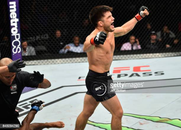 Henry Cejudo celebrates his knockout victory over Wilson Reis of Brazil in their flyweight bout during the UFC 215 event inside the Rogers Place on...