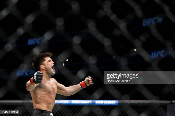 Henry Cejudo celebrates his victory against Wilson Reis during UFC 215 at Rogers Place on September 9 2017 in Edmonton Canada