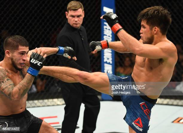 Henry Cejudo kicks Sergio Pettis in their flyweight bout during the UFC 218 event inside Little Caesars Arena on December 02 2017 in Detroit Michigan