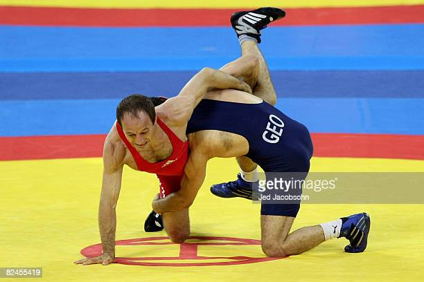 Henry Cejudo of the United States competes against Besarion Gochashvili of Georgia in the men's freestyle 55 kg wrestling event at the China...