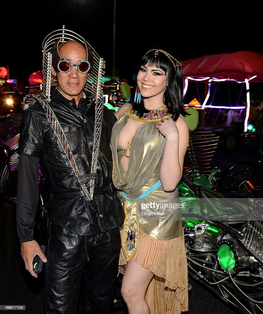 Henry Chang (L), driver of the MisterFusion Artcar, and model and parade queen <a gi-track='captionPersonalityLinkClicked' href=/galleries/search?phrase=Claire+Sinclair&family=editorial&specificpeople=6960124 ng-click='$event.stopPropagation()'>Claire Sinclair</a> attend the fourth annual Las Vegas Halloween Parade on October 31, 2013 in Las Vegas, Nevada.