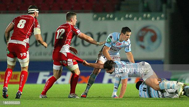 Henry Chavancy of Racing Metro 92 pulls the shorts of Scott Williams during a European Cup game between Scarlets and Racing Metro 92 at Parc y...
