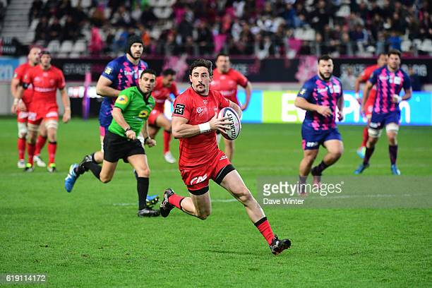 Henry Clunies Ross of Lyon makes a break during the French Top 14 between Stade Francais and Lyon OU at Stade Jean Bouin on October 29 2016 in Paris...