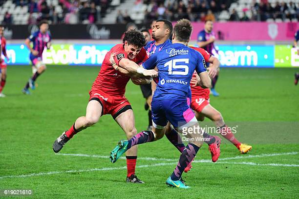 Henry Clunies Ross of Lyon takes on Hugo Bonneval of Stade Francais Paris and Will Genia of Stade Francais Paris during the French Top 14 between...