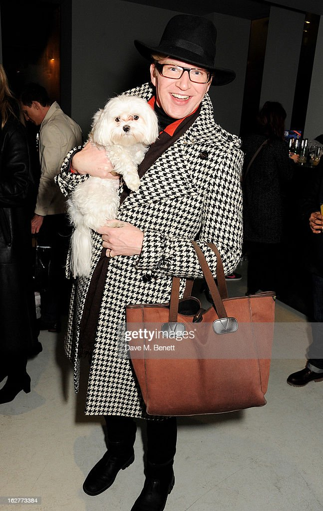 Henry Conway and Frankie Benett attend a private view of Bill Wyman's new exhibit 'Reworked' at Rook & Raven Gallery on February 26, 2013 in London, England.