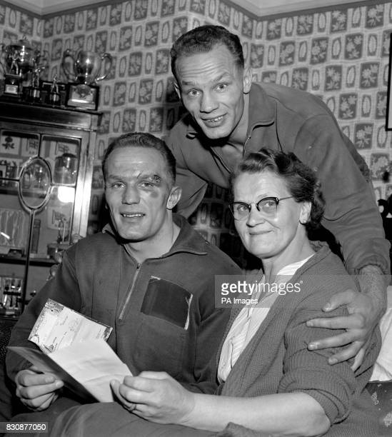 Henry Cooper who upset the American world ratings with his great win over Arizona banker Zora Folley at Wembley reads messages of congratulations at...