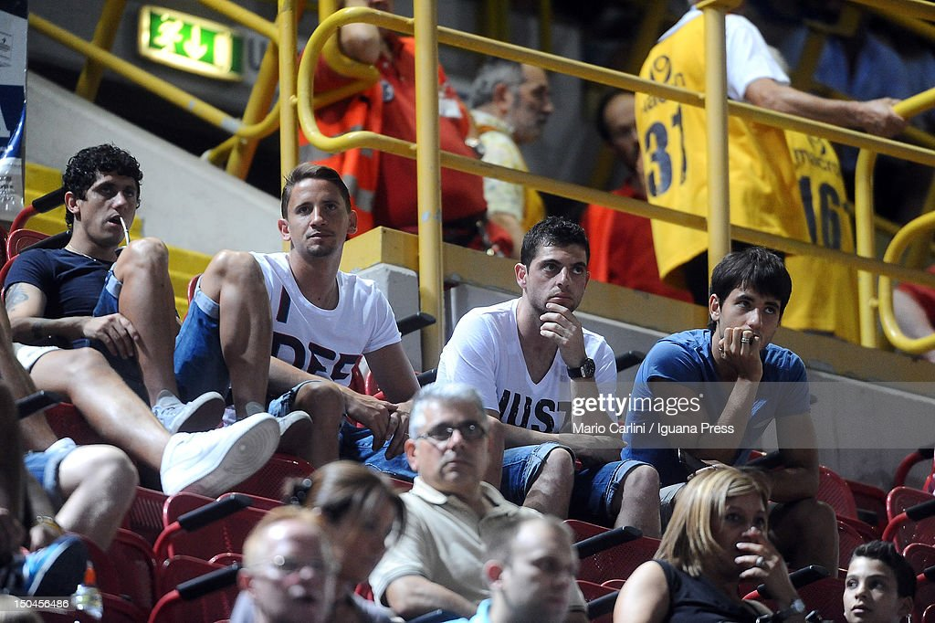 Henry Damian Gimenez (L) and <a gi-track='captionPersonalityLinkClicked' href=/galleries/search?phrase=Gaston+Ramirez&family=editorial&specificpeople=6335880 ng-click='$event.stopPropagation()'>Gaston Ramirez</a> (C) watch the action from the stands during thweTIM Cup match between Bologna FC and AS Varese at Stadio Renato Dall'Ara on August 18, 2012 in Bologna, Italy.