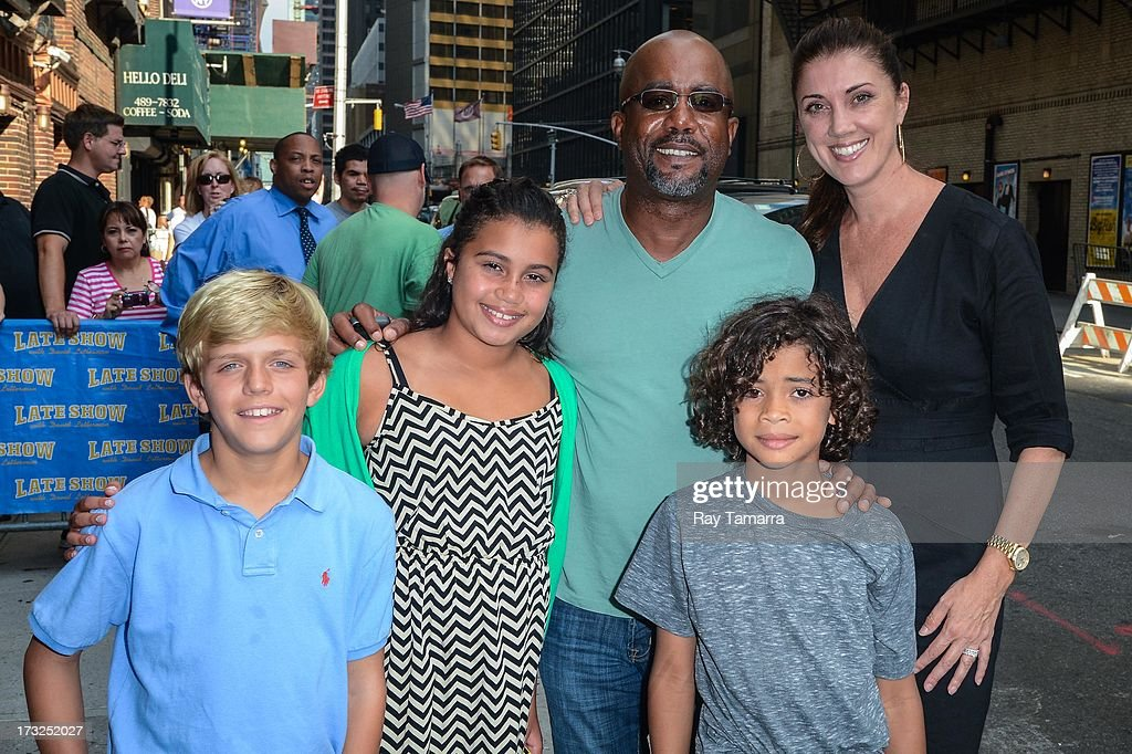 Henry Dew, Dani Rucker, singer Darius Rucker, Jack Rucker, and Beth Rucker leave the 'Late Show With David Letterman' taping at the Ed Sullivan Theater on July 10, 2013 in New York City.
