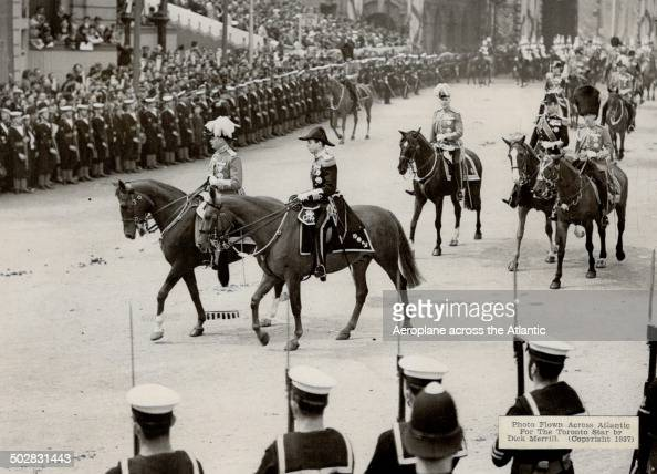 Henry Duke of Gloucester and George Duke of Kent brothers of the King riding in the procession en route to Westminister Abbey [Incomplete]