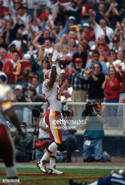 Henry Ellard of the Washington Redskins celebrates after catching a touchdown pass against the Detroit Lions during an NFL football game November 9...