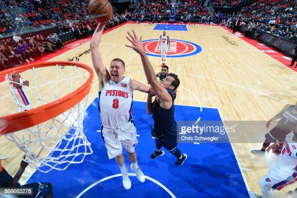 Henry Ellenson of the Detroit Pistons drives to the basket against the Minnesota Timberwolves on October 25 2017 at Little Caesars Arena in Detroit...