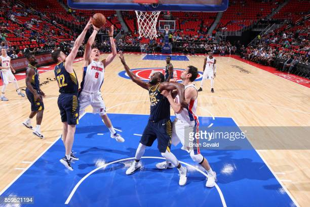 Henry Ellenson of the Detroit Pistons goes to the basket against the Indiana Pacers on October 9 2017 at Little Caesars Arena in Detroit Michigan...
