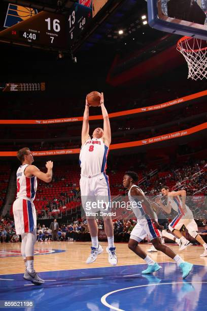 Henry Ellenson of the Detroit Pistons grabs the rebound against the Indiana Pacers on October 9 2017 at Little Caesars Arena in Detroit Michigan NOTE...
