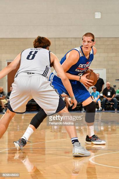 Henry Ellenson of the Detroit Pistons looks to drive to the basket while guarded by Ding Yanyuhang of the Dallas Mavericks during the Mountain Dew...
