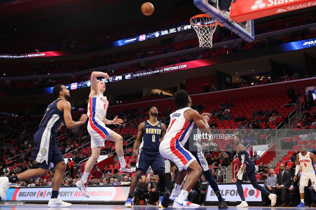 Henry Ellenson #8 of the Detroit Pistons shoots the ball during the game against the Denver Nuggets at Little Caesars Arena on December 12, 2017 in Detroit, Michigan.