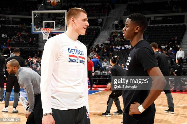 Henry Ellenson of the Detroit Pistons talks with Caris LeVert of the Brooklyn Nets before the game on March 30 2017 at The Palace of Auburn Hills in...