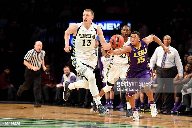 Henry Ellenson of the Marquette Golden Eagles dribbles up court during game one of the Legends Classic college basketball tournament against the LSU...