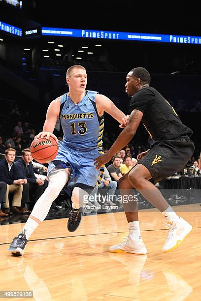 Henry Ellenson of the Marquette Golden Eagles drives against Willie Atwood of the Arizona State Sun Devils during the championship game of the...