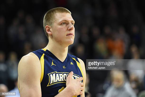 Henry Ellenson of the Marquette Golden Eagles looks on during the National Anthem before a college basketball game against the Providence Friars at...