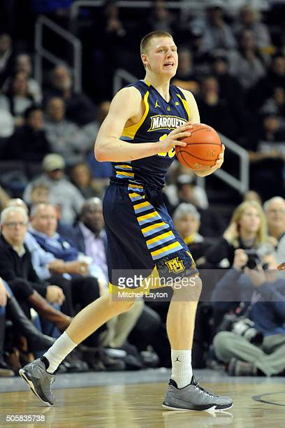 Henry Ellenson of the Marquette Golden Eagles looks too pass the ball during a college basketball game against the Marquette Golden Eagles at Dunkin'...