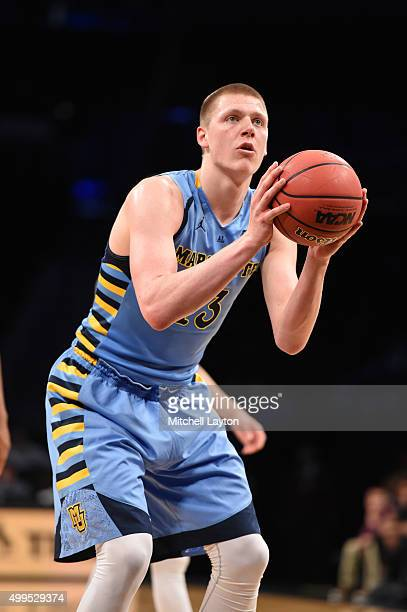 Henry Ellenson of the Marquette Golden Eagles takes a foul shot during the championship game of the Legends Classic college basketball tournament at...