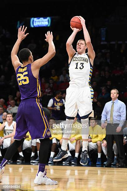 Henry Ellenson of the Marquette Golden Eagles takes a jump shot over Ben Simmons of the LSU Tigers during game one of the Legends Classic college...