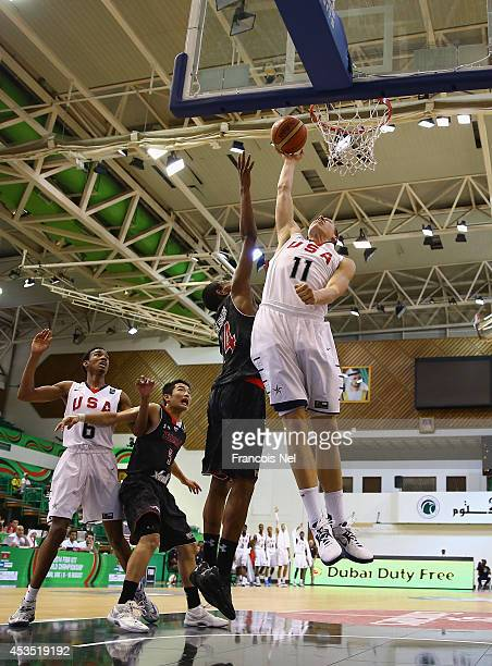 Henry Elleson of the United States shoots against Rui Hachimura of Japan during the FIBA U17 World Championships Group Match between Japan and United...