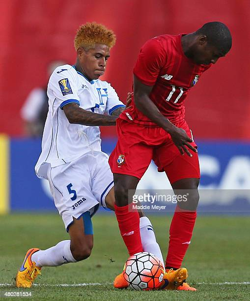 Henry Figueroa of Honduras defends Armando Cooper of Panama during the 2015 CONCACAF Gold Cup match between Honduras and Panama at Gillette Stadium...