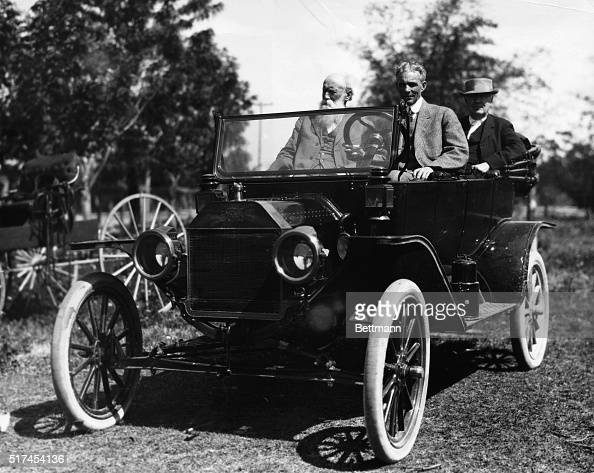 Henry Ford at wheel John Burroughs and Thomas Edison in back seat of the Model T