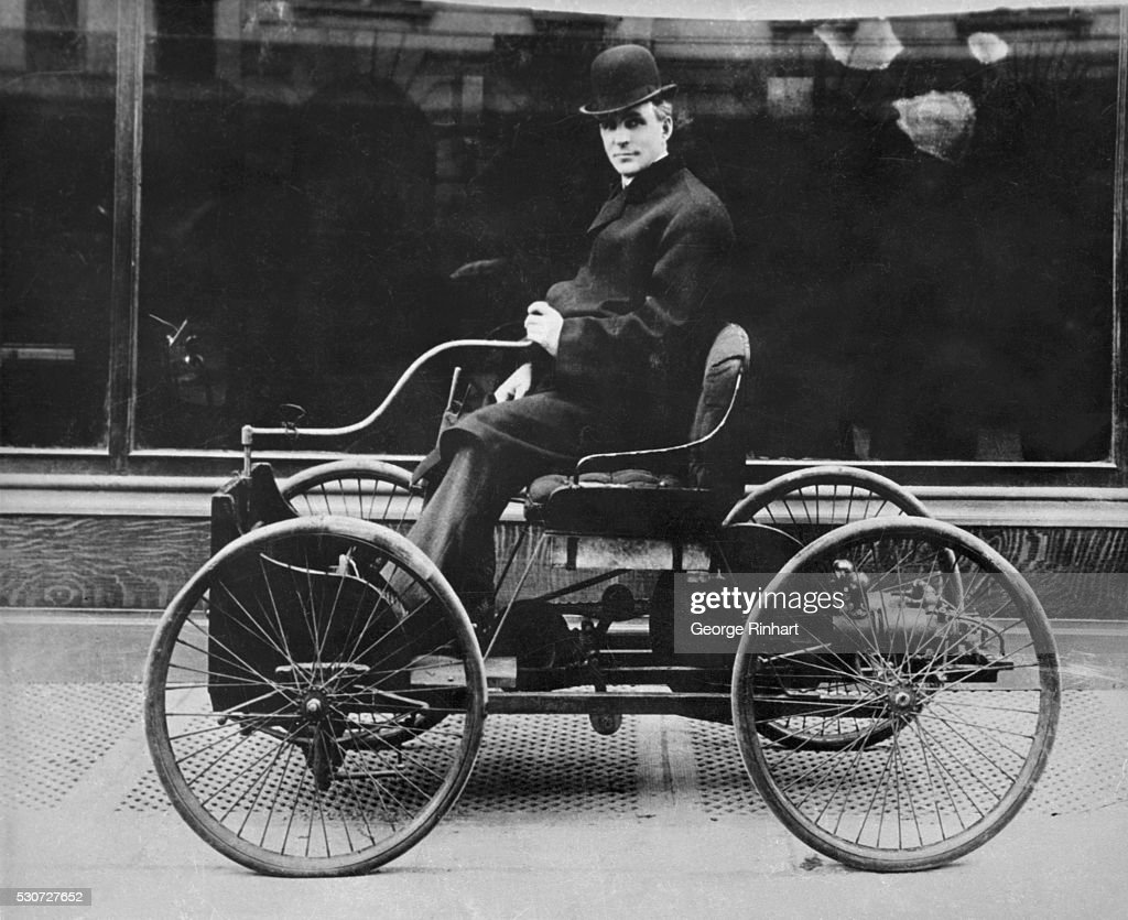 Henry Ford drives his first car through the streets of Detroit ca. 1893. & Henry Ford Seated in Early Automobile Pictures | Getty Images markmcfarlin.com