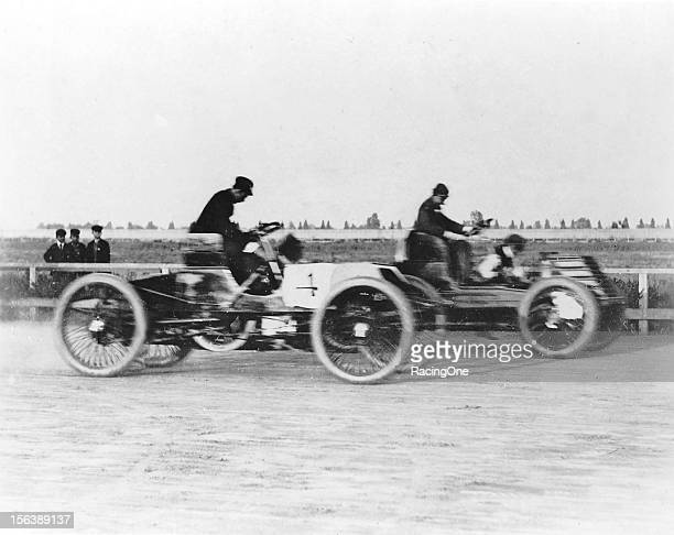 Henry Ford is about to pass Alexander Winton on his way to winning one of the earlier automobile races in the United States
