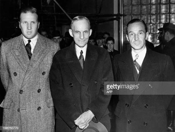Henry Ford US car manufacturer his grandson Henry Ford II and son Edsel Ford three generations of Fords pose for a photographer 05 April 1939 at the...