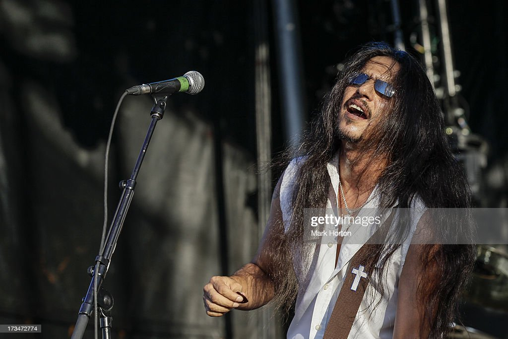 <a gi-track='captionPersonalityLinkClicked' href=/galleries/search?phrase=Henry+Garza&family=editorial&specificpeople=220941 ng-click='$event.stopPropagation()'>Henry Garza</a> of Los Lonely Boys performs on Day 10 of the RBC Royal Bank Bluesfest on July 14, 2013 in Ottawa, Canada.