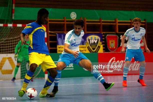 Henry Haferkorn of FC Schalke 04 challenges Marvin AppiahKorung of SC Fuerstenfeldbruck during the B and C Juniors German Indoor Football...