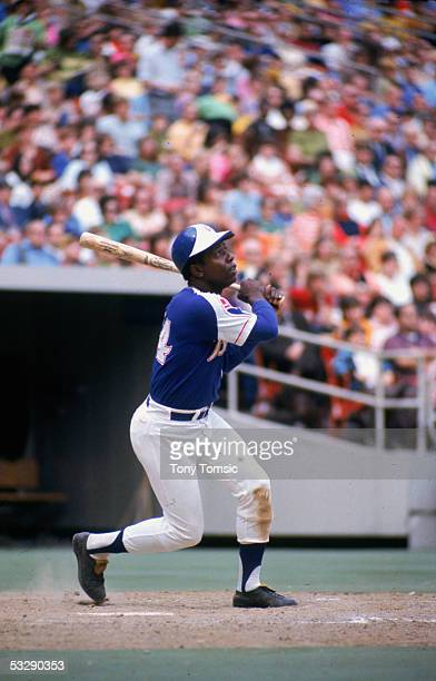 Henry 'Hank' Aaron of the Atlanta Braves watches the flight of his hit during an MLB game at AtlantaFulton County Stadium in Atlanta Georgia