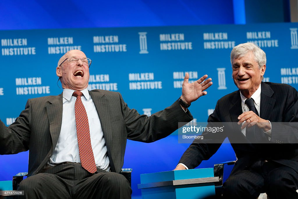 Henry 'Hank' Paulson, chairman and founder of the Paulson Institute and former U.S. Treasury secretary, left, and Robert Rubin, co-chairman at the Council of Foreign Relations and former U.S. Treasury Secretary, laugh during the annual Milken Institute Global Conference in Beverly Hills, California, U.S., on Monday, April 27, 2015. The conference brings together hundreds of chief executive officers, senior government officials and leading figures in the global capital markets for discussions on social, political and economic challenges. Photographer: Patrick T. Fallon/Bloomberg via Getty Images